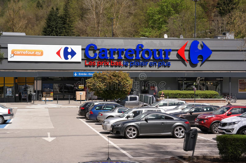 Carrefour Hypermarket. MALMEDY, BELGIUM - MAY 2015: Entrance and parking of a Carrefour hypermarket - Carrefour is a French multinational retailer, and one of stock images