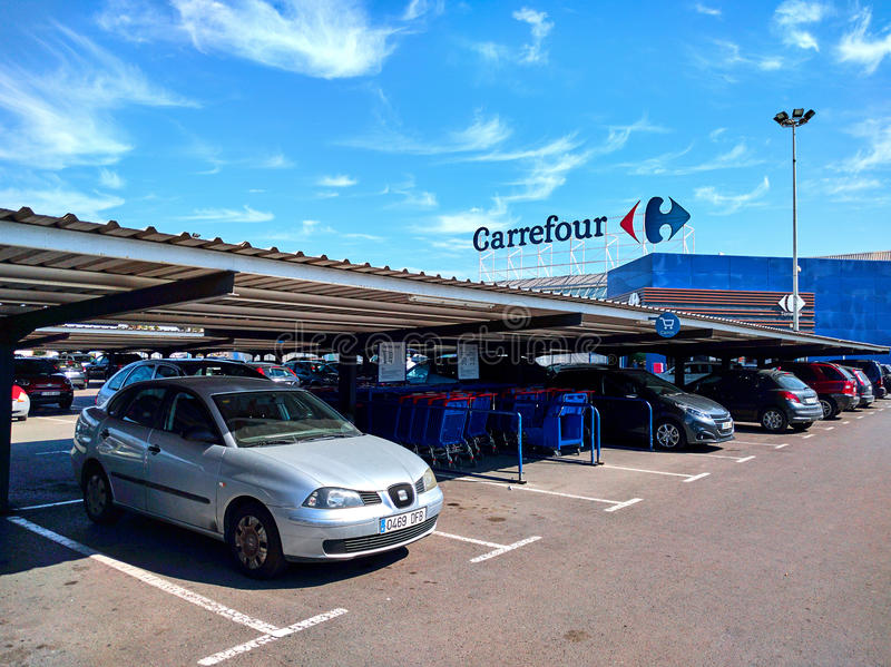 Carrefour hypermarket. Torrevieja, Spain - March 17, 2017: Parking and facade of Carrefour hypermarket. Carrefour is a French multinational retailer, and one of royalty free stock image