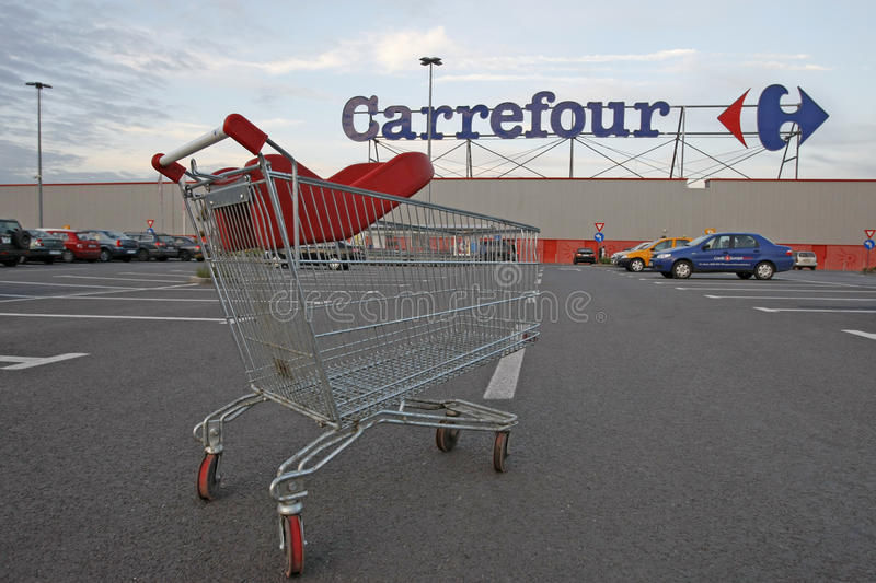 Carrefour Supermarket Logo And Shopping Cart Editorial Photography