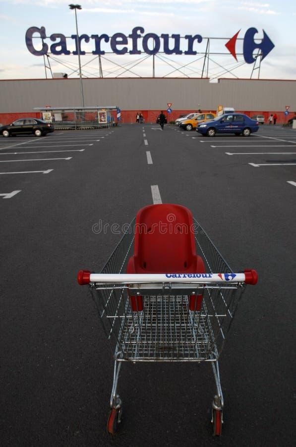 Carrefour supermarket logo and shopping cart stock photos