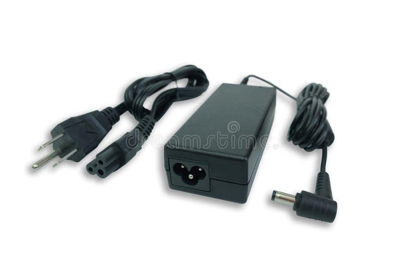 Carregador do poder do adaptador ac/dc com o fio do laptop isolado no branco fotografia de stock