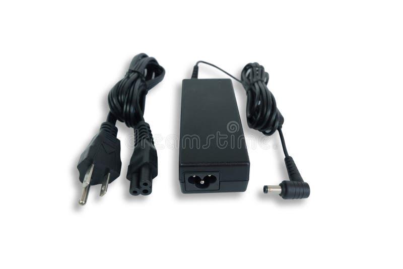 Carregador do poder do adaptador ac/dc com o fio do laptop isolado no branco imagem de stock