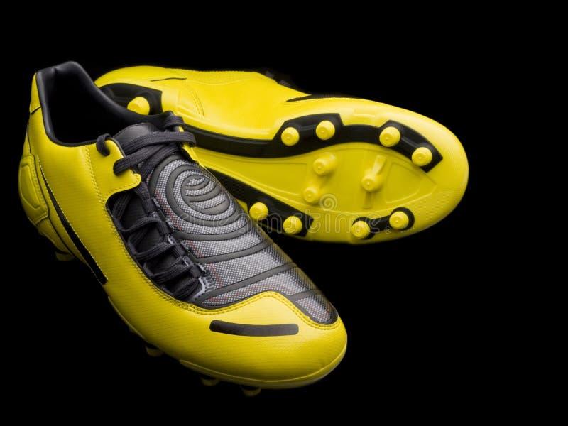 Carregadores amarelos do futebol fotos de stock