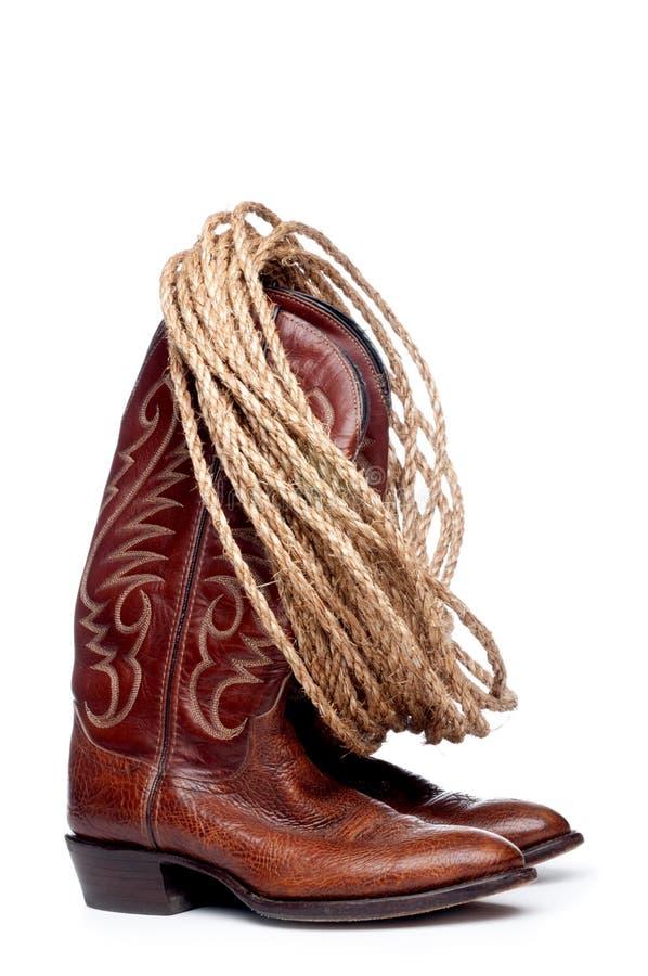 Carregadores de cowboy de Brown e uma bobina de corda imagens de stock