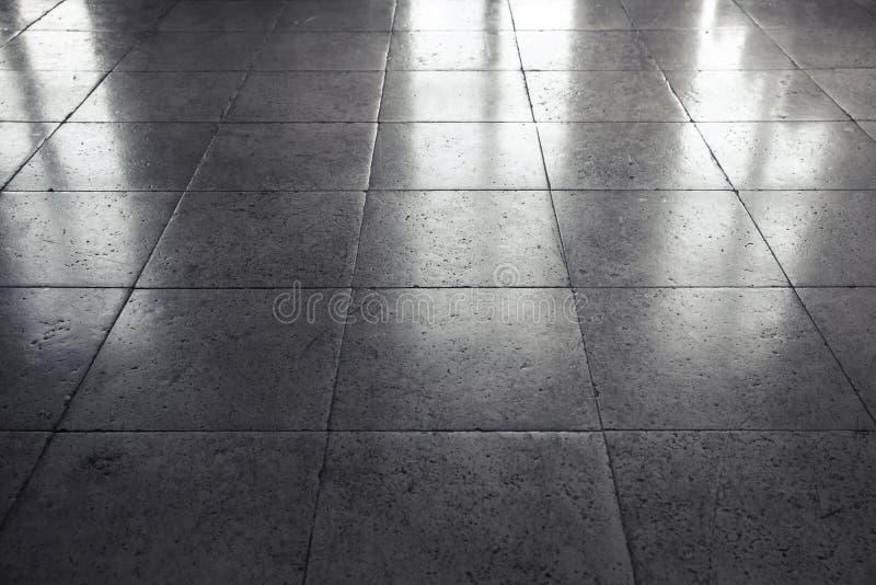 Carrelage en pierre gris brillant de plancher, fond image libre de droits