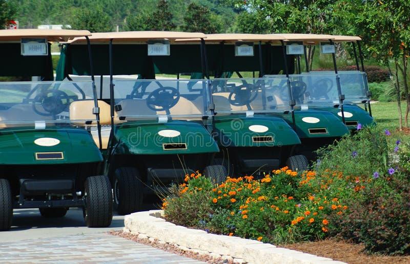 Carrelli di golf per affitto fotografie stock