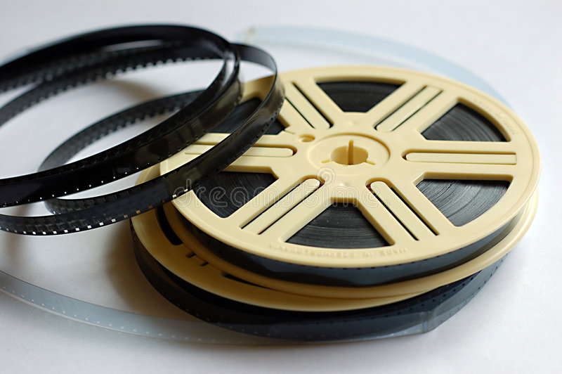Carretéis de película no fundo branco fotos de stock