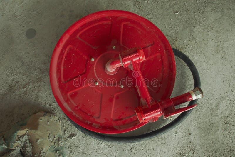 Carrete de la manguera de bomberos imagenes de archivo