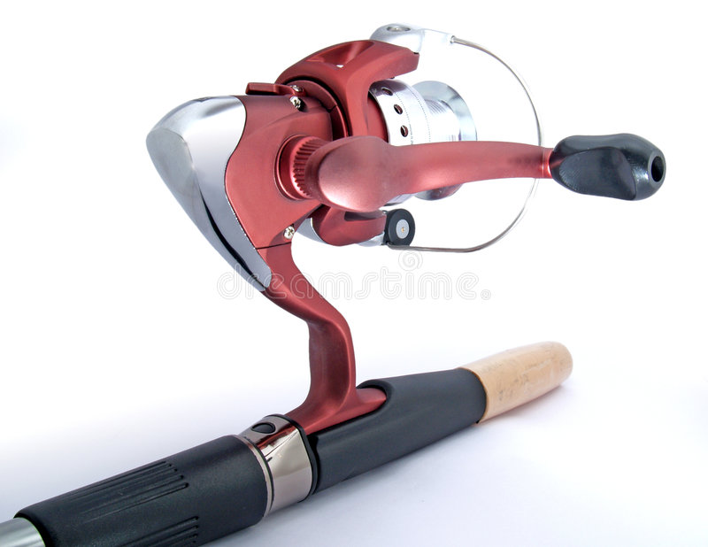 Carrete de la pesca en la barra fotografía de archivo libre de regalías