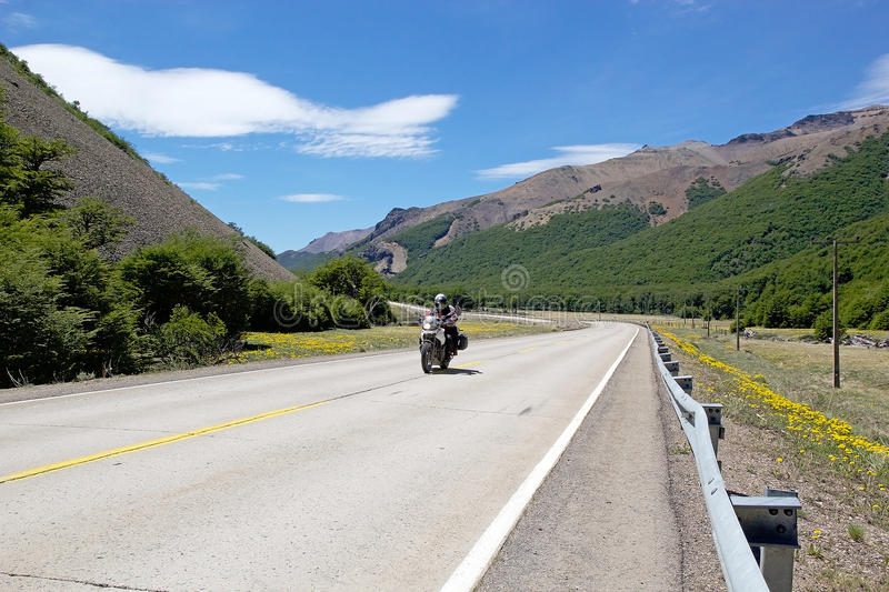 The Carretera Austral, Chile. Tourist is driving a motorcycle along the higest point of the Carretera Austral in Chile. Carretera Austral is the Chile`s Route 7 stock photos