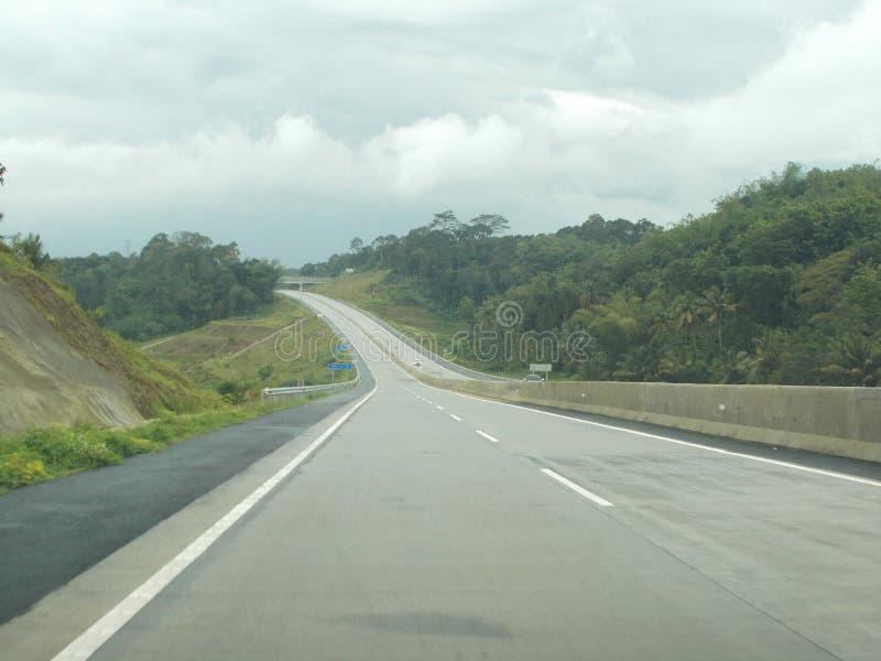 Carretera con curvas en peaje del thr imagen de archivo