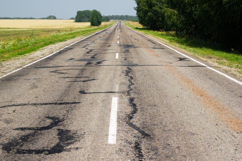 Carretera de asfalto vieja imagen de archivo libre de regalías