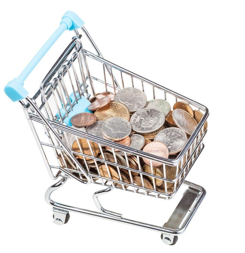 Carretilla de las compras con las monedas de los E.E.U.U. aisladas imagen de archivo