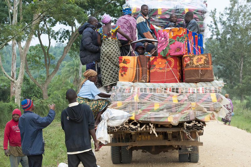 Passenger transportation in Africa, people and ware on open transporter stock images