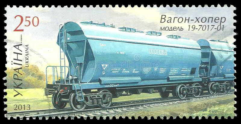 Carriage on rails. Ukraine - stamp 2013: Color edition on Railway, shows Carriage on rails royalty free stock photo