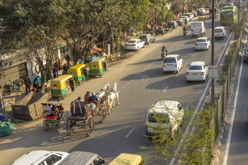 Carriage with two white horses in city traffic on Indian streets aerial view royalty free stock photos