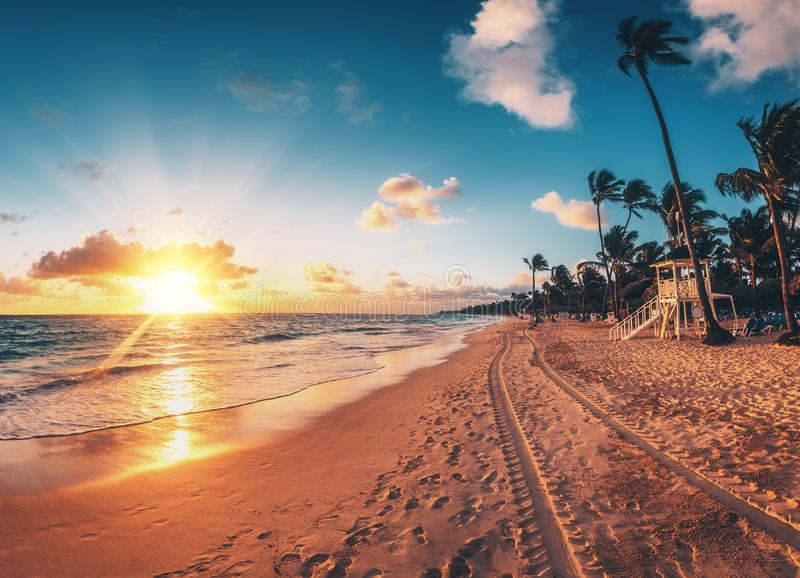 Carribean vacation, beautiful sunrise over tropical beach stock photo