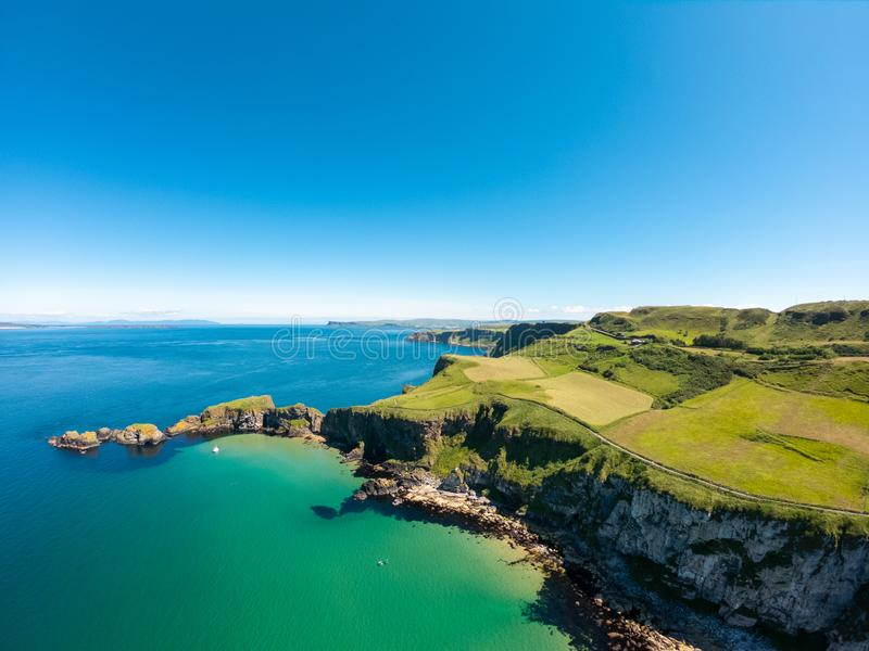 Carrick a Rede Rope Bridge in Ballintoy Northern Ireland. Aerial view on Cliffs and turquoise Atlantic Ocean water stock photo
