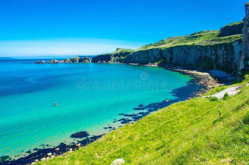 Carrick a Rede Rope Bridge in Ballintoy, Northern Ireland. Beautiful Landscape on Coast of Atlantic Ocean, Clear blue and green wa stock images