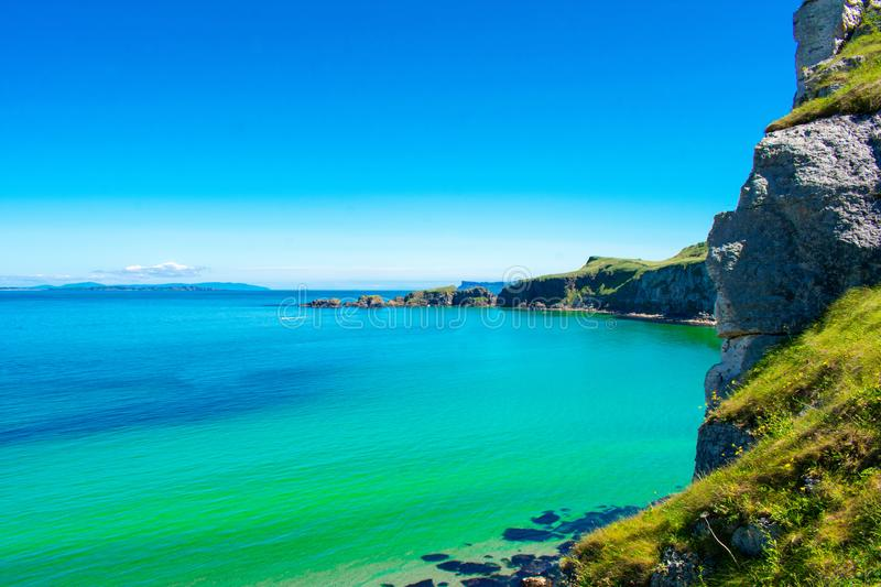 Carrick a Rede Rope Bridge in Ballintoy, Northern Ireland. Beautiful Landscape on Coast of Atlantic Ocean, Clear blue and green wa stock photography