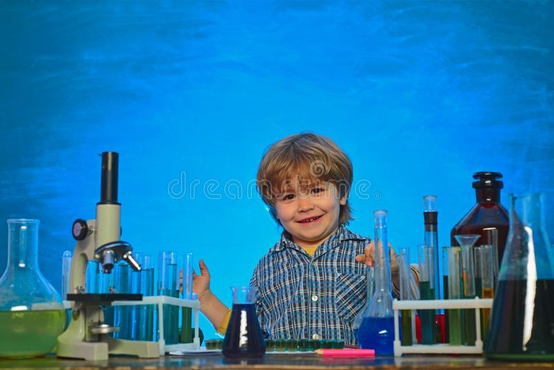 They carried out a new experiment in chemistry. Home schooling. Happy little scientist making experiment with test tube stock photography