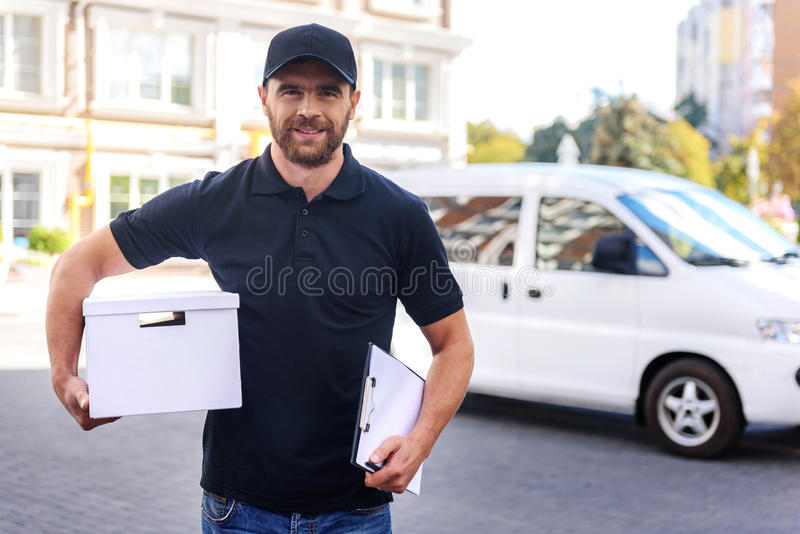 Carrier walking from the commercial delivery van stock photography