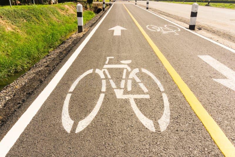 Carril de bicicleta con sol foto de archivo