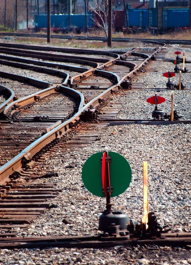 Carriles del tren e indicadores del interruptor imagen de archivo