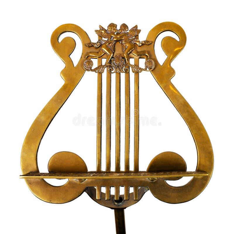 Carrinho de música antigo, bronze, no fundo branco imagens de stock royalty free