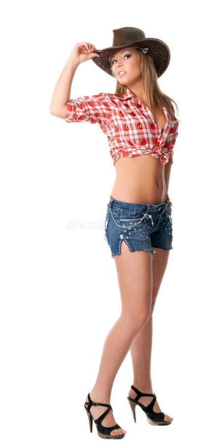 Carrinho do cowgirl e chapéu novos 'sexy' da tomada imagens de stock