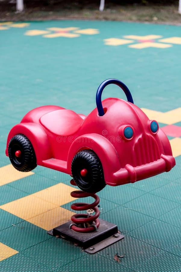 Carro colorido do brinquedo no campo de jogos fotografia de stock