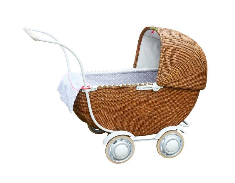 Carro de bebé del vintage aislado en blanco con la trayectoria de recortes fotografía de archivo