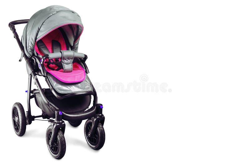 Carro de bebé rosado aislado en el fondo blanco fotos de archivo libres de regalías