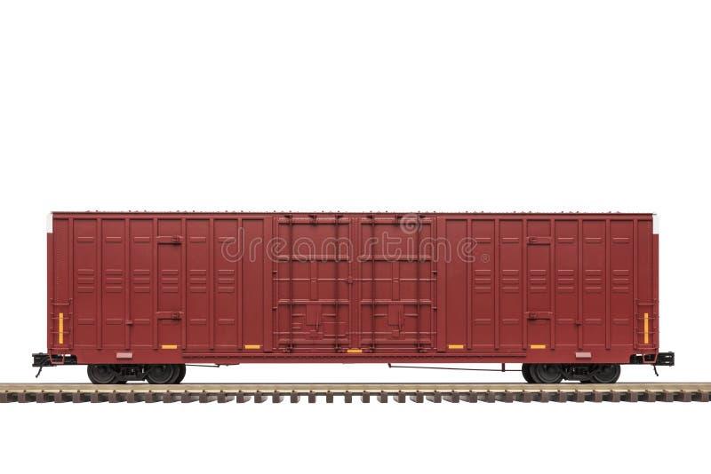 Carro de caixa marrom da estrada de ferro na trilha fotografia de stock