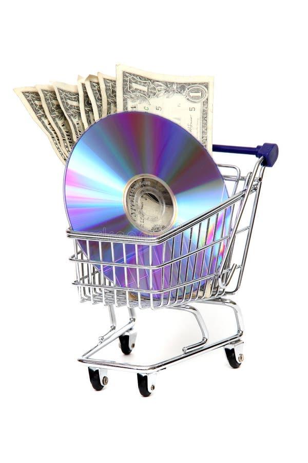 Carro de compra com dólares e DVD fotos de stock