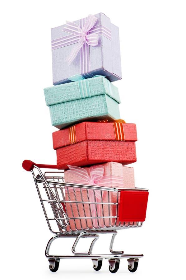 Carro de compra e giftboxes imagem de stock royalty free