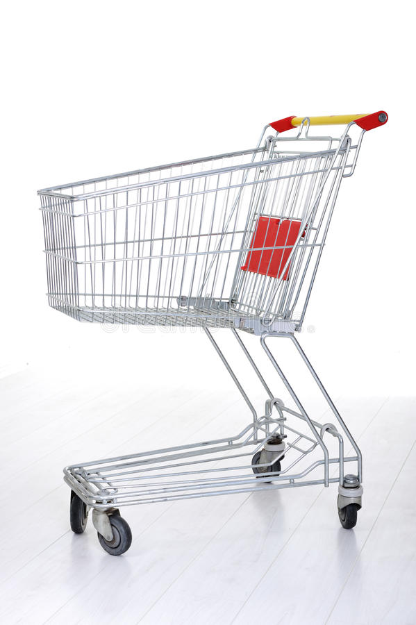 Carro de compra no branco fotografia de stock royalty free