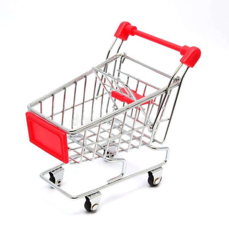 Carro de compras aislado en el fondo blanco foto de archivo