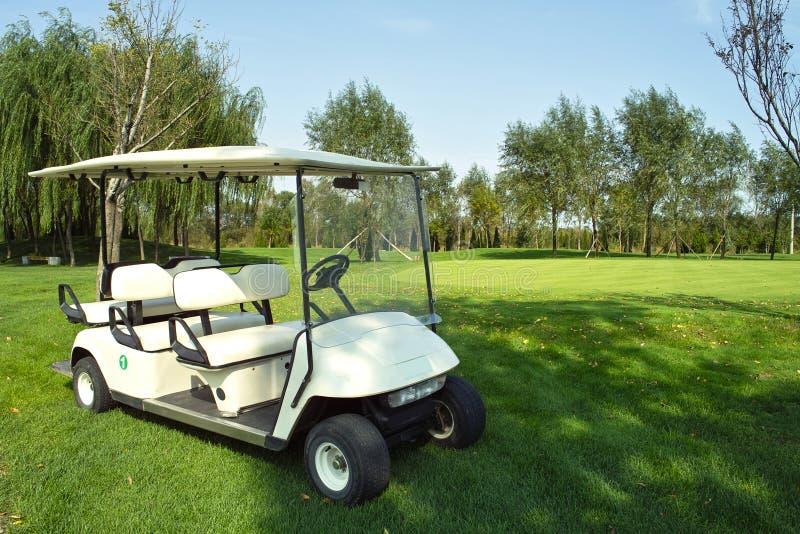 Carro de golfe fotografia de stock
