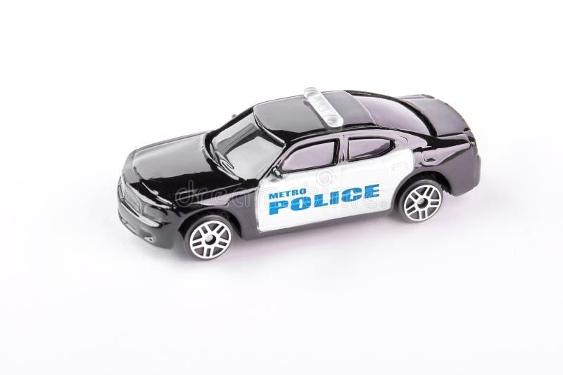 Carro de polícia do brinquedo isolado no fundo branco imagens de stock royalty free
