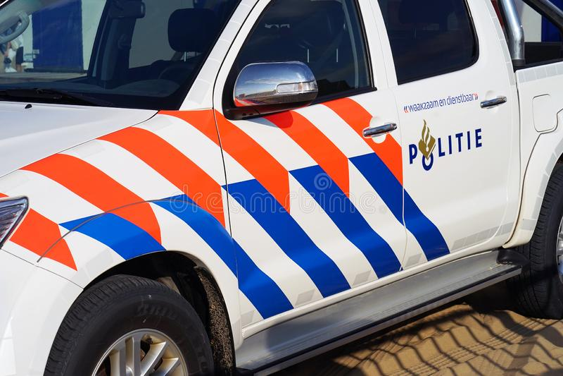 Carro de polícia nos Países Baixos Vista lateral imagem de stock royalty free