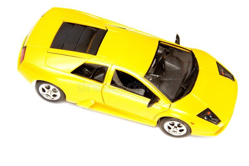 Carro desportivo amarelo do brinquedo foto de stock