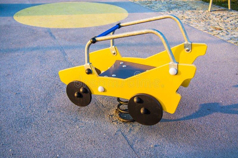 Carro do brinquedo no campo de jogos fotos de stock