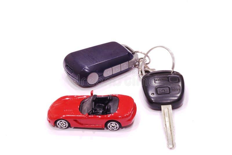 Carro vermelho do brinquedo com uma parte superior aberta foto de stock