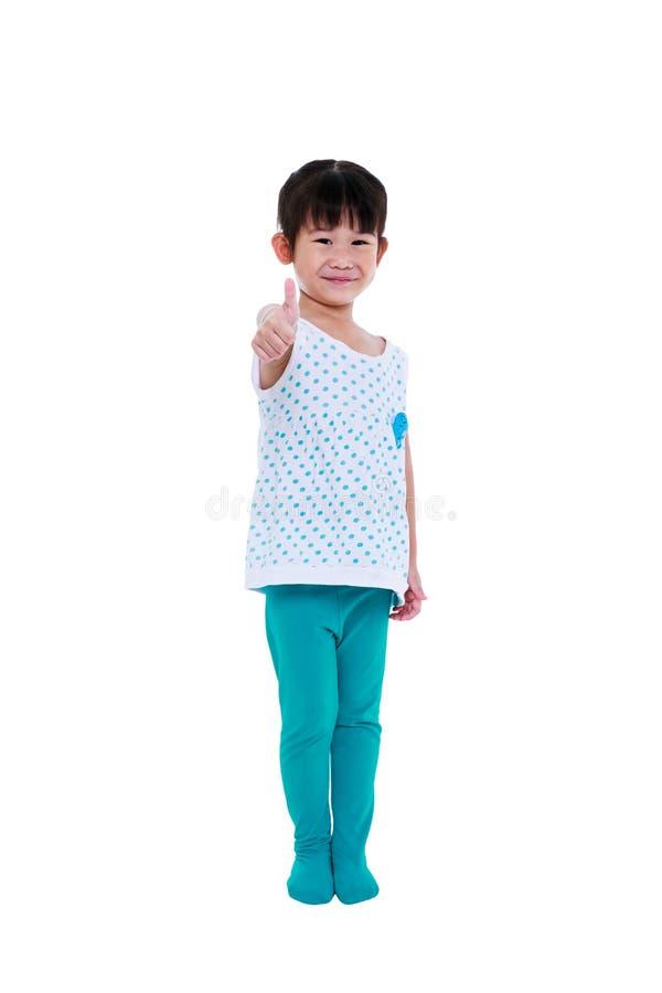 Carrocería completa La muchacha asiática adorable que sonríe y que muestra manosea con los dedos encima de sig fotografía de archivo