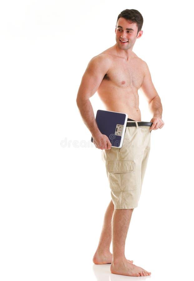Carrocería masculina muscular de la escala en blanco foto de archivo libre de regalías