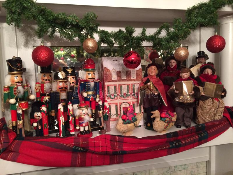 Carroling With The Nutcrackers. Nutcrackers and Victorian family singing Christmas carols with accompaniment of geese stock photos
