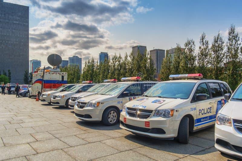 Carros da polícia e dos meios de Montreal imagem de stock royalty free