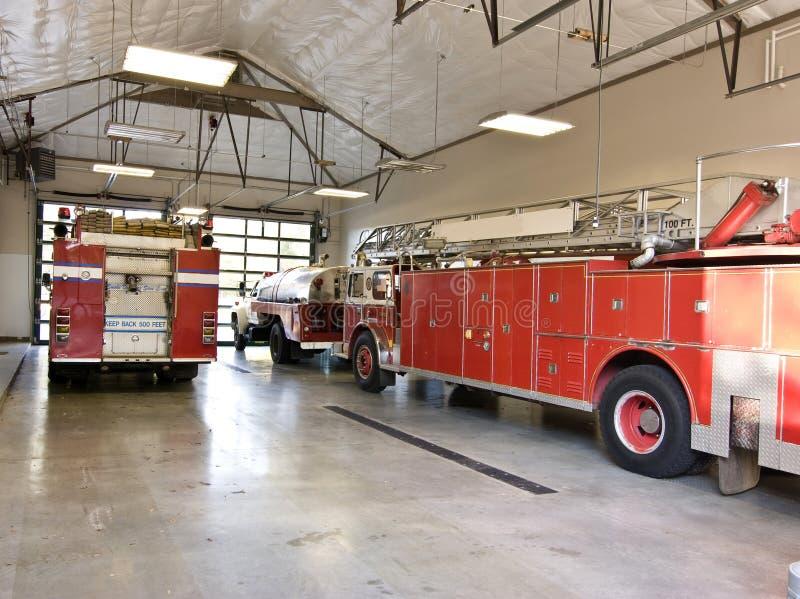 Carros de bombeiros na garagem fotografia de stock royalty free