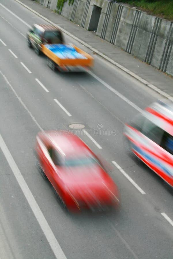 Carros no movimento fotografia de stock